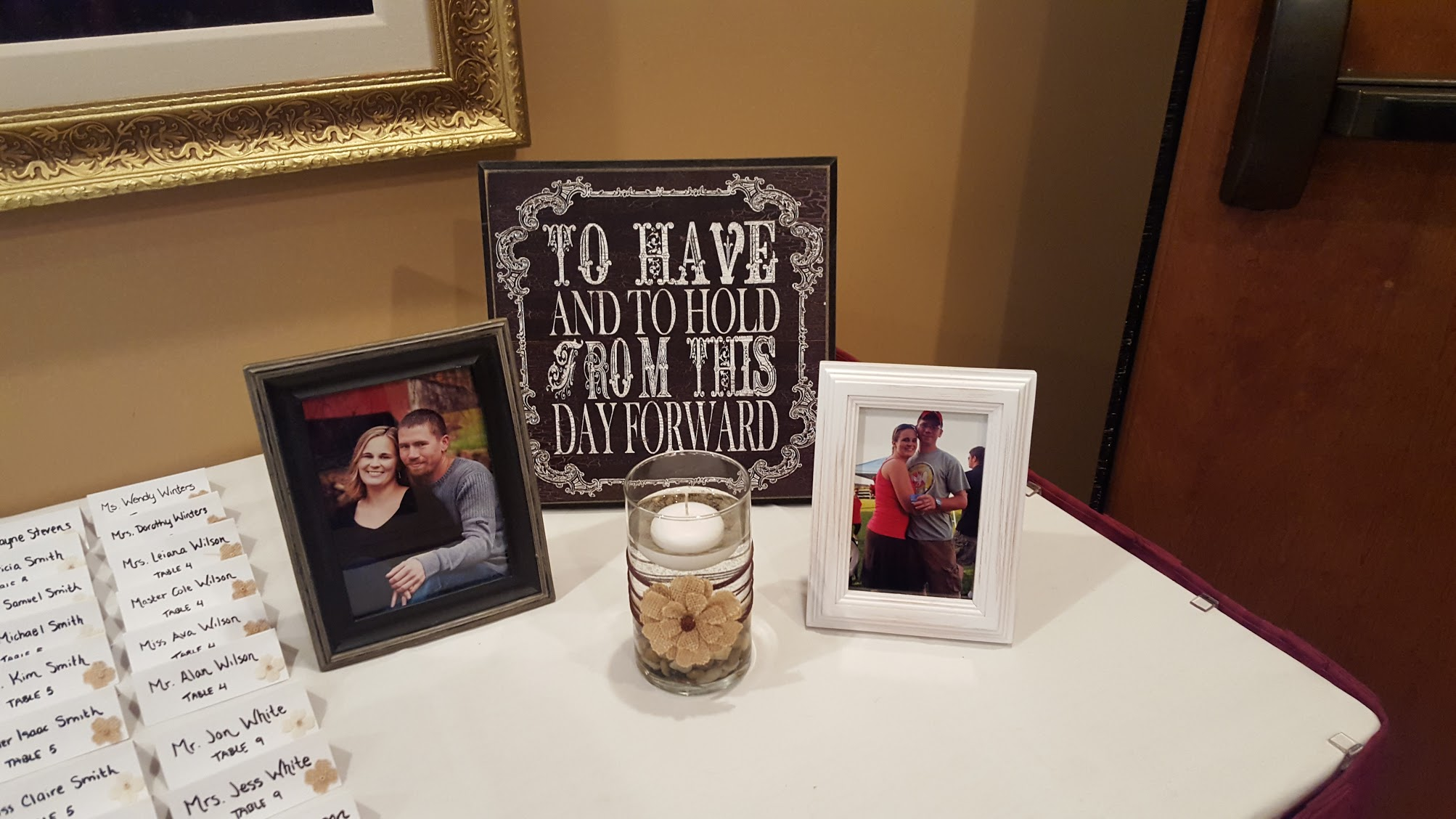 Wedding table with cards and photos