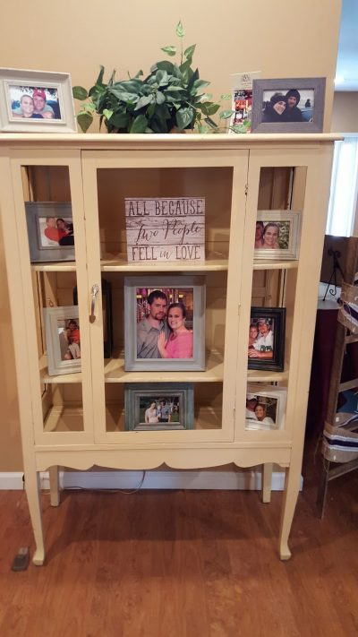 Cabinet with wedding couple photos inside