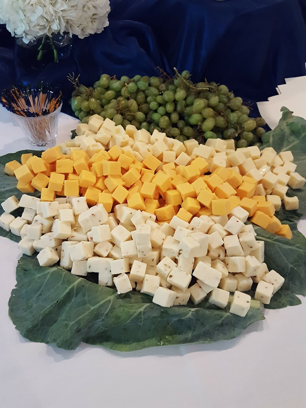 Variety of cheese and grapes